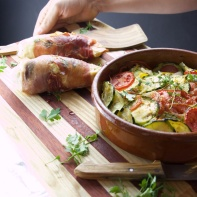 Cured ham rolled chicken and grilled Mediterranean zucchini pot