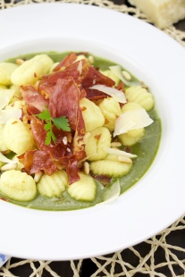 Gnocchi on a spinach sauce with crispy cured ham