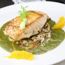 Salmon on spinach sauce and bean fennel salad