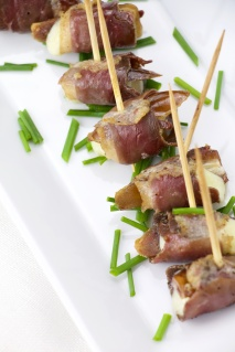 Cured duck, dates and cheddar rolls bites