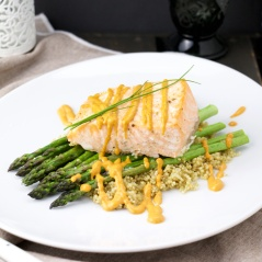 Salmon on asparagus and romesco