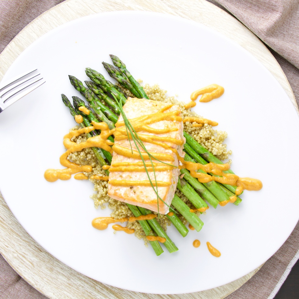 Spanish Salmon on a quinoa and green asparagus bed and romesco sauce
